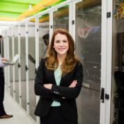 technician-standing-in-a-server-farm